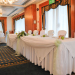 Stylish Seating Table Swags, Chair Covers and Sashes. Photograph © Hemma Mason Photography.