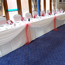 With the addition of Stylish Seating Table Covers and Swags.