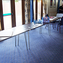 Standard furniture before being dressed with Table Covers.