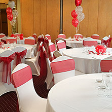 With the addition of Stylish Seating Chair Covers and Sashes.